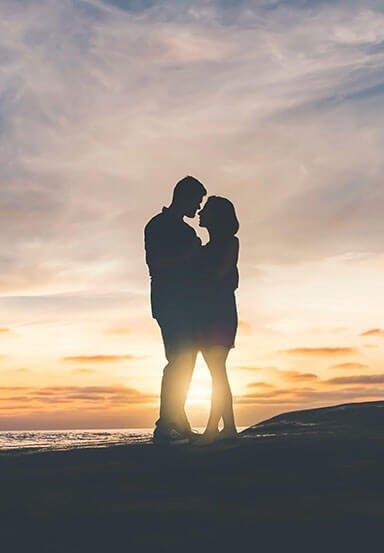 Couple standing on beach